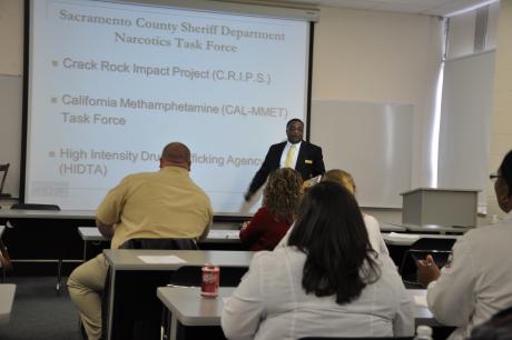 Assistant Professor Brooks instructing class