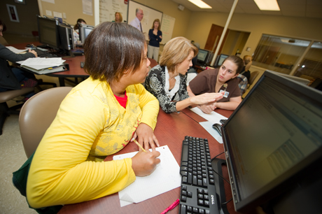 Instructor helping students in tutoring lab.