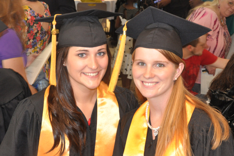 Photo of two DSCC students at graduation