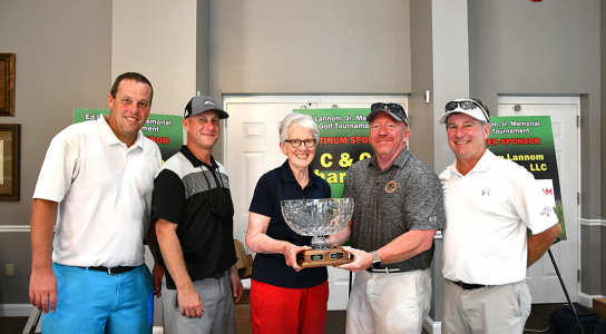 City of Newbern posing with their golf tournament trophy