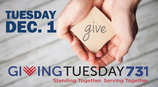 Giving Tuesday 731 image of hands holding a piece of paper that says give