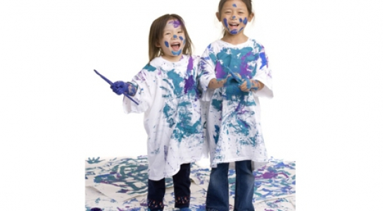 Children covered in paint laughing