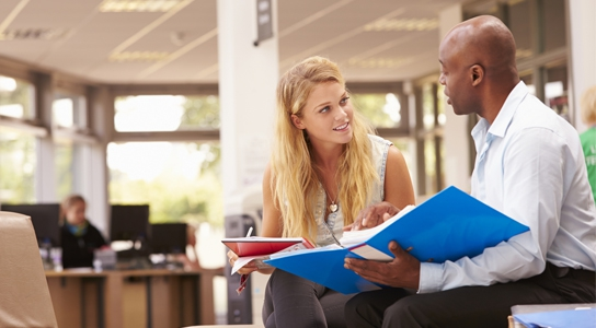 Students meeting in the library.