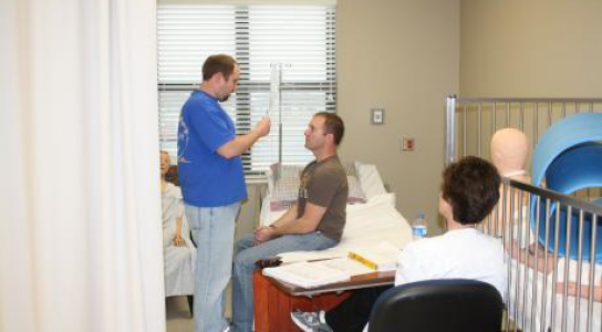 Students in Nursing lab practicing patient care.